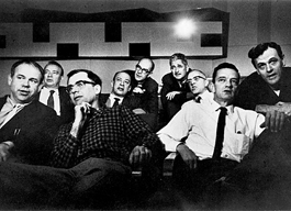 Disney's Nine Old Men - copyright Walt Disney Company. Early 1950s. Left to Right: Ward Kimball, Eric Larson, Frank Thomas, Marc Davis, Ollie Johnston, Les Clark, Milt Kahl, John Lounsbery and Wolfgang